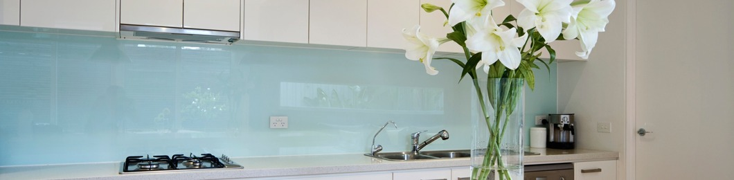 Green glass splashback for the kitchen